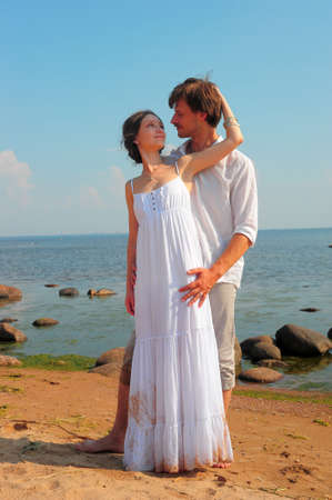 newly wedded couple: young couple in love on the shore Stock Photo