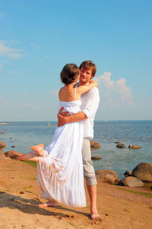 Beautiful couple at the beach  photo