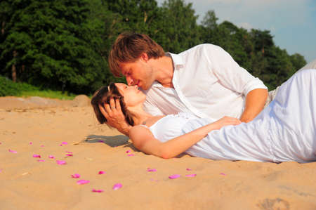 couple kissing while lying on the shore Stock Photo - 11489107