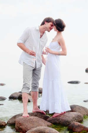 Young happy couple on the beach  Stock Photo - 13501146