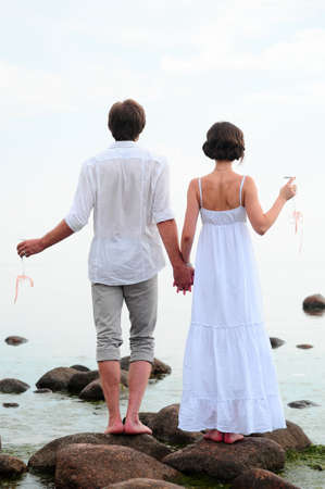 Young happy couple on the beach Stock Photo - 13501153