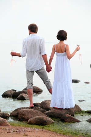 Young happy couple on the beach  Stock Photo - 13501171