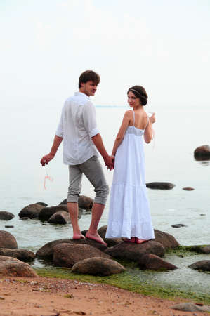 Young happy couple on the beach  photo