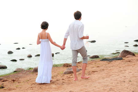 Young happy couple on the beach Stock Photo - 13501172