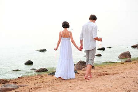 Young happy couple on the beach Stock Photo - 13501170