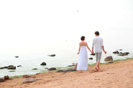 Young happy couple on the beach Stock Photo - 13501183
