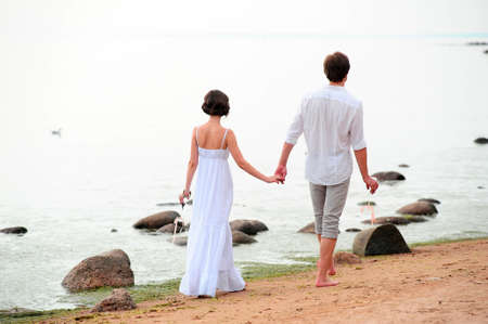 Young happy couple on the beach Stock Photo - 13501176