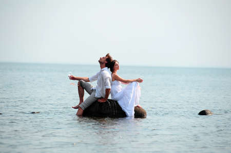 romantic pair on the seashore photo
