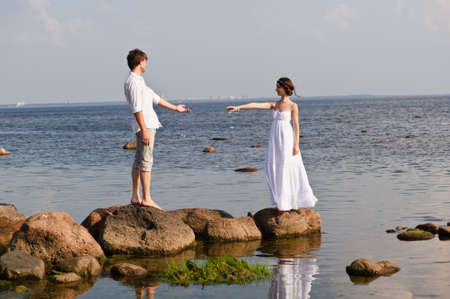 romantic pair on the seashore Stock Photo - 13326199