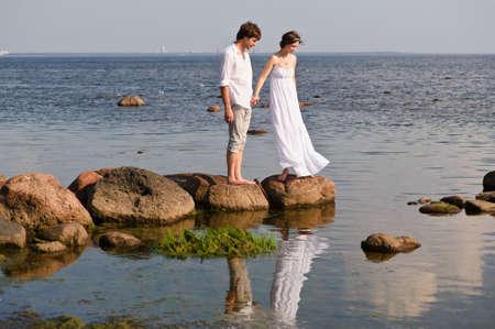 romantic pair on the seashore photo