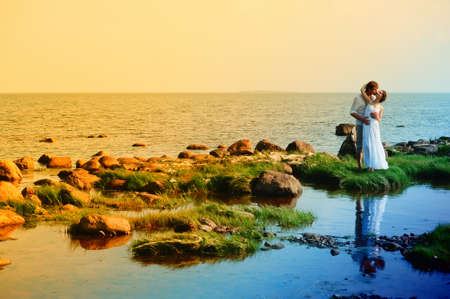 honeymoon couple: romantic couple at sea Stock Photo
