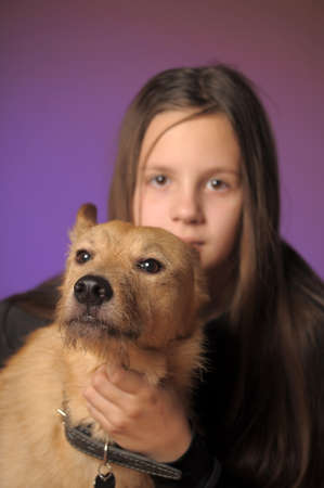 teen girl with a red dog photo