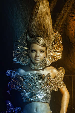 girl in silver and foil  Stock Photo - 11357914
