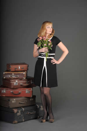 young woman and a lot of old suitcases Stock Photo - 11471867