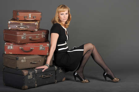 young woman and a lot of old suitcases Stock Photo - 11471848
