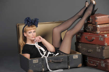 young woman and a lot of old suitcases Stock Photo - 11420775