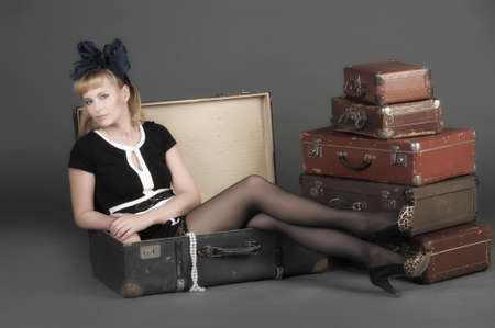 young woman and a lot of old suitcases Stock Photo - 11420794