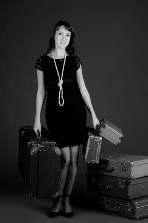young woman and a lot of old suitcases Stock Photo - 11420739