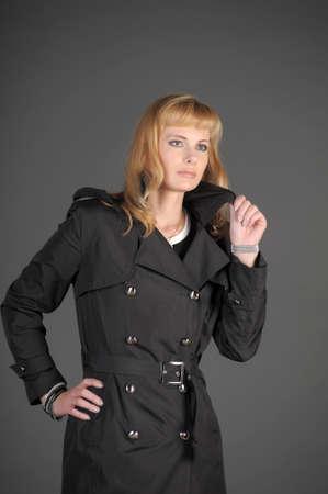 young blonde in a dark cloak photo