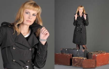 young woman and a lot of old suitcases Stock Photo - 11420771