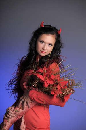 s horn: Female red devil Stock Photo