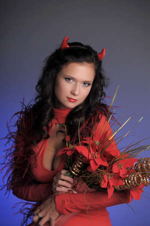 horny: Female red devil Stock Photo