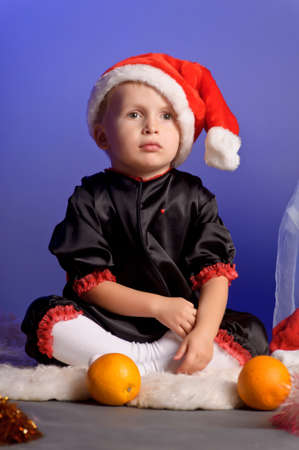 boy in the Christmas hat with orange photo