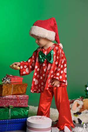 little boy and a lot of Christmas gifts photo