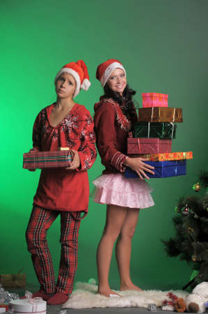 Two beautiful girls with gifts  photo