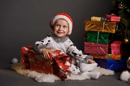 little boy and a lot of Christmas gifts Stock Photo - 11830565