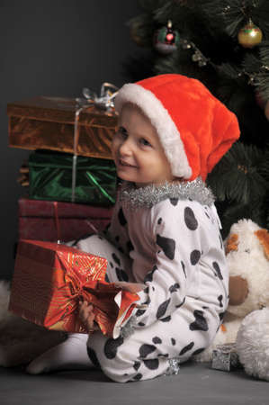 little boy and a lot of Christmas gifts Stock Photo - 11830561