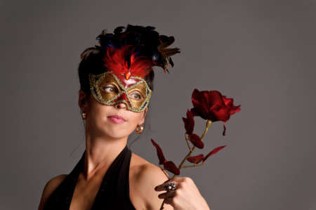 Girl with red rose and mask  photo