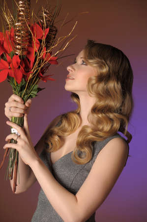 Vintage attractive blonde woman with a Christmas flower Stock Photo - 13571944