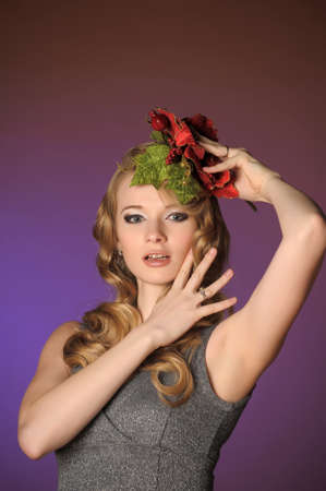 Vintage attractive blonde woman with a Christmas flower Stock Photo - 13572036
