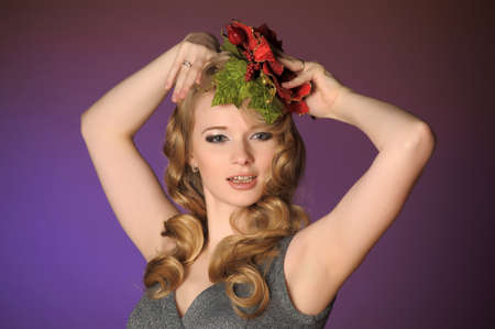 Vintage attractive blonde woman with a Christmas flower Stock Photo - 13572020