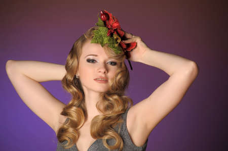 Vintage attractive blonde woman with a Christmas flower photo