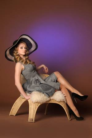 the beautiful young girl in a big hat in studio Stock Photo - 13306354