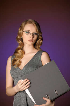 attractive blonde secretary in a gray dress Stock Photo - 11476503