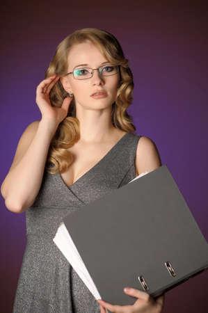 attractive blonde secretary in a gray dress Stock Photo - 11476465