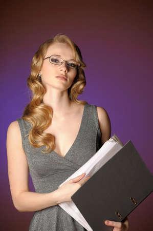 attractive blonde secretary in a gray dress Stock Photo - 11476467