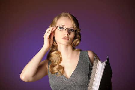 attractive blonde secretary in a gray dress Stock Photo - 11476581