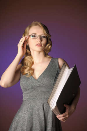 attractive blonde secretary in a gray dress Stock Photo - 11476474