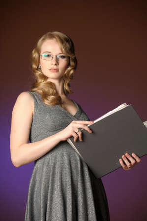 attractive blonde secretary in a gray dress Stock Photo - 11476515