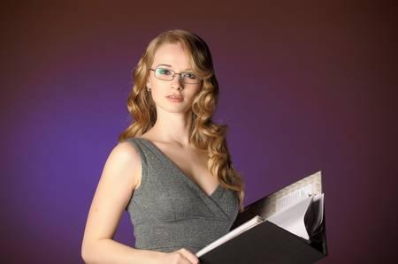 attractive blonde secretary in a gray dress Stock Photo - 11476618