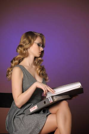 attractive blonde secretary in a gray dress Stock Photo - 11476574