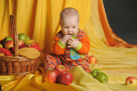 little girl and basket of apples photo