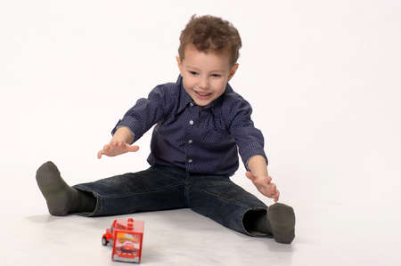 boy playing with cars photo