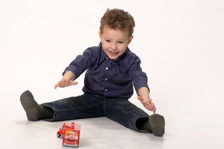 kindergartner: boy playing with cars Stock Photo