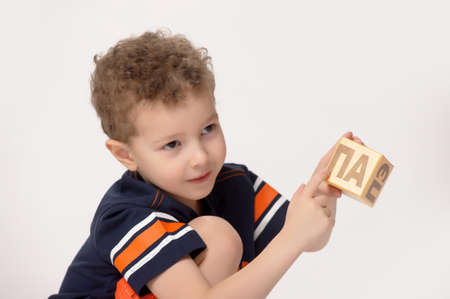 boy playing with blocks photo