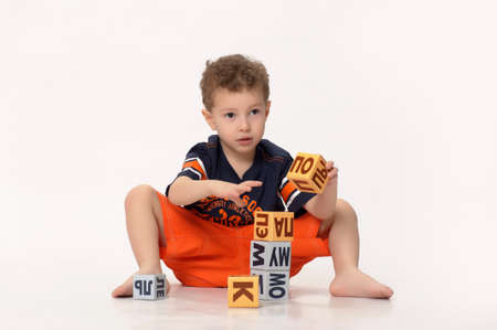 boy playing with blocks Stock Photo